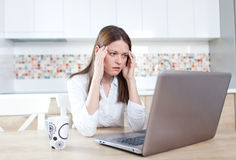 Something went wrong. Young woman having trouble with laptop Stock Photography