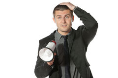 Something wrong. Portrait of a young business man holding megaphone Stock Photo