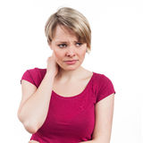Something is wrong. Portrait of a woman looking worried or in pain, isolated on white Stock Photo