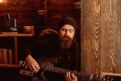 Sometimes music is all you need. Bearded man play the guitar. Rock guitarist playing music. Rock style man. Rock and. Somes music is all you need. Bearded man stock photos