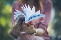 Sometimes it is necessary to turn a new leaf into life. Business woman reading book. Close up stock image