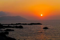 Summer sunset. Sometimes the sun gives a last burst of colour before it finally sets. This picture was taken in the north corner of Africa, in the city of Ceuta stock photo