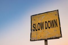 Sometimes you need to slow down. Traffic sign saying to slow down. In life, sometimes, it would be good for us to also have a sign advising us that we`re going Royalty Free Stock Photos