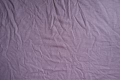 Somewhat jammed pink viscose fabric. From above Royalty Free Stock Images