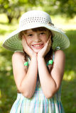 Somewhat surprised cheerful girl. In the hat Stock Photography