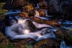 Night time view of spring river flowing in mountains. Somewhere deep within Altai mountains, Russia Royalty Free Stock Photography
