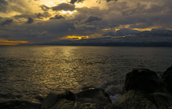 Somewhere in The Distance. Decent Winter Afternoon Sunset by The Adriatic Sea in Rijeka, Croatia, photographed from The Sea Rocks on The Coast Stock Image