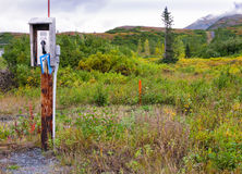 Somewhere near Copper (Ahtna) River Alaska. This is an odd-placed telephone on a pole somewhere in the Copper River Valley in the eastern interior region of royalty free stock images