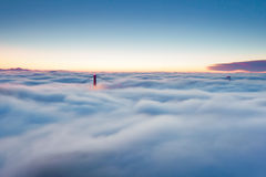 Somewhere Out There. San Francisco, California dissappears among the fog and clouds as only the towers of the Golden Gate find their way through Stock Photography