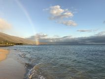 Somewhere over the rainbow. Beautiful rainbow in Maui Royalty Free Stock Images