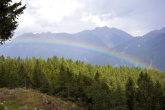 Somewhere over the Rainbow. Rainbow seen from above. Photo shot in the Bavarian Alps Royalty Free Stock Photo