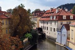 Somewhere in Prague. Beautiful houses and the river mill. Autumn. Near the Charles bridge royalty free stock photo