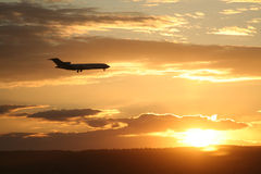 Somewhere warm. A plane flying into the sunset hopefully landing somewhere warm (Actually going to Calgary Airport Stock Photography
