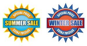 Sommar- och vinterförsäljningstecken Arkivbilder