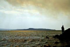 Sommarafton på det Azov havet Arkivbild