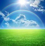Landskap med en regnbåge Royaltyfria Bilder