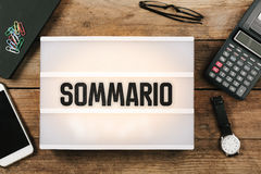 Sommario, Italian text for Summary in vintage style light box on. Sommario, Italian text for Summary, , vintage style light box on office desktop, high angle stock image