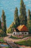 Sommarlandskap med ett litet hus Arkivfoton
