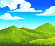 Sommarliggande med gröna kullar Arkivfoto