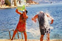 Sommartradition av vatten spelar i den Kastellorizo ön, Grekland, Juli 19 2009 Arkivbilder