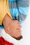 sommeil de téléphones d'homme de chapeau d'oreille de Noël Photographie stock libre de droits