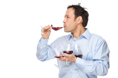 The sommelier. Full isolated studio picture from a man tasting some wine Royalty Free Stock Images
