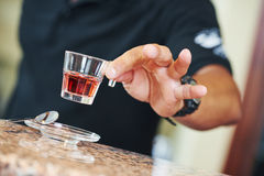 Sommelier barman with glass of liquor Stock Images
