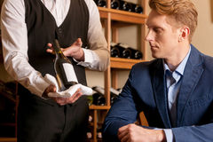 Sommelier and customer. Stock Photos