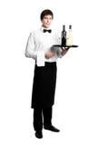 Sommelier de serveur avec des bouteilles Images stock