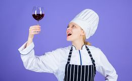 Sommelier enjoy wine. Excellent taste. Sommelier skills. Serving wine at restaurant. Woman chef hold glass of wine stock photo