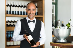 Sommelier holding wine bottle Royalty Free Stock Photography