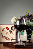 Sommelier kit and tools composition. Sommelier tools with a red wineglass and grapes composition Royalty Free Stock Photo