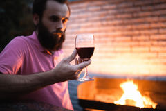 Sommelier look at glass with red wine;. Bartender taste delicious french or italian alcohol Royalty Free Stock Photos