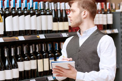 Sommelier with a note pad Royalty Free Stock Image