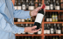 Sommelier offering bottle of red wine to customer Royalty Free Stock Photos