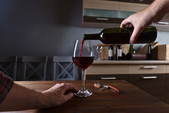 Sommelier pouring red wine into a glass Royalty Free Stock Images