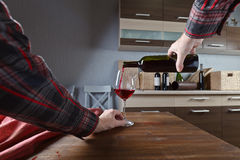 Sommelier pouring red wine into a glass Royalty Free Stock Photos