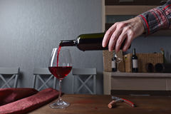 Sommelier pouring red wine into a glass Royalty Free Stock Image