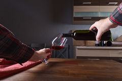 Sommelier pouring red wine into a glass Stock Images