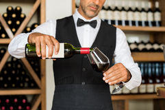Sommelier pouring wine Stock Photos