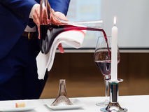 Sommelier pouring wine to glass Stock Images