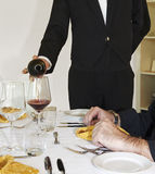 Sommelier. A sommelier pours the wine into a glass Stock Photos