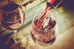 Wine Tasting, Restaurant, St. Valentine`s Day, close up. Sommelier pours wine into a glass. Date, Wine Tasting, Restaurant, St. Valentine`s Day royalty free stock image