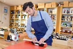 Sommelier preparing wine bottle for present Royalty Free Stock Photography