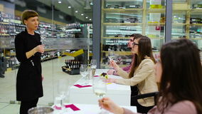 The sommelier present the wine to people on degustation stock video footage