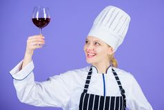 Sommelier skills. Serving wine at restaurant. Woman chef hold glass of wine. Outstanding toasts that work for any stock photography