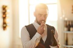 Sommelier Smelling Cork fotografia stock