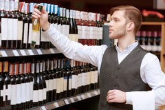 Sommelier in the store near shelves Stock Photos