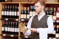 Sommelier in the store near shelves Stock Image