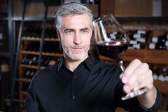 Sommelier tasting red wine Stock Images